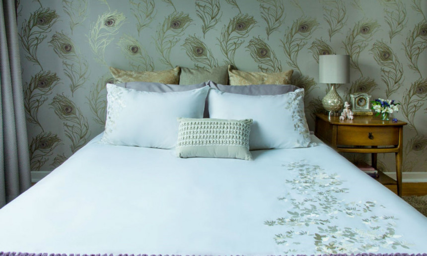 masterbedroom-with-robert-allen-peacock-wallpaper-and-white-and-purple-beding