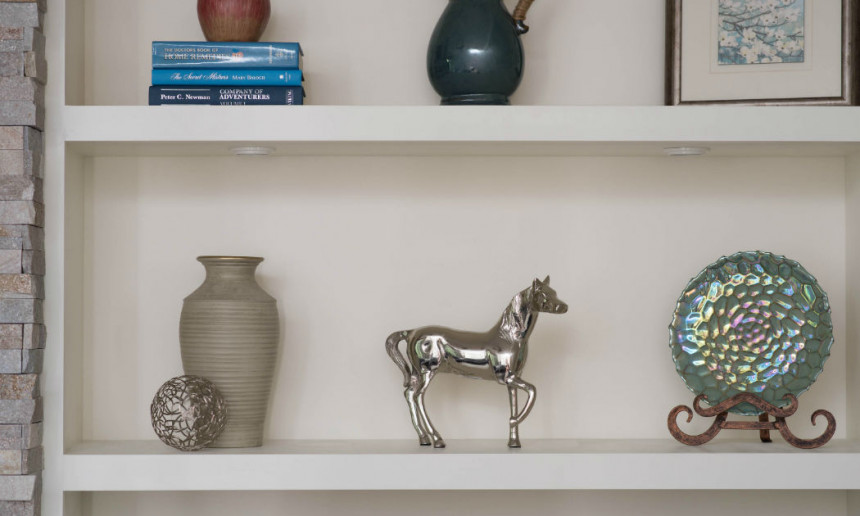 open-shelving-with-metal-art-and-decor-in-formal-living-room-design-2