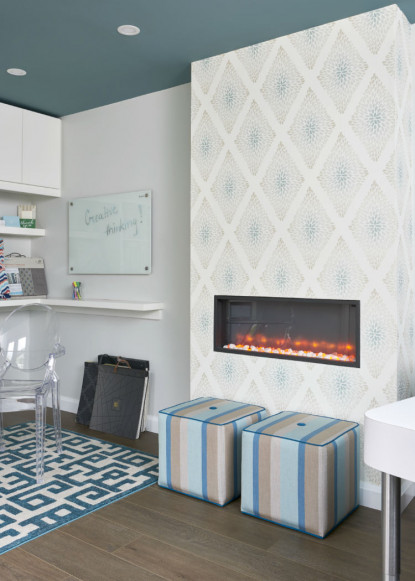 painted-ceiling-and-wallpaper-fireplace-and-striped-fabric-seats-with-geometric-patterned-rug