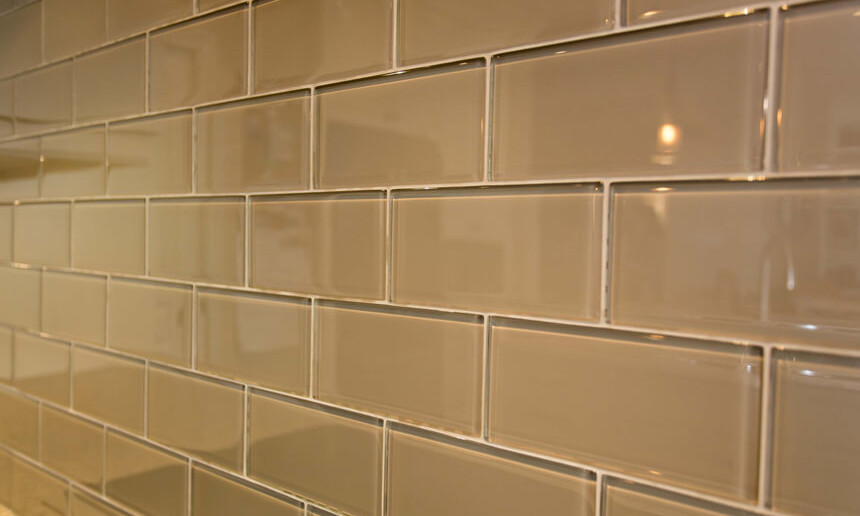 painted-glass-subway-tile-backsplash-in-traditional-kitchen