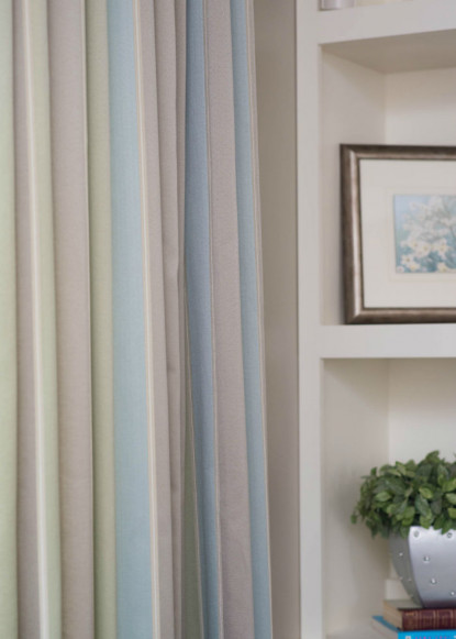 pastel-coloured-curtains-in-living-room-with-plant-decor-and-custom-built-in-cabinetry-2