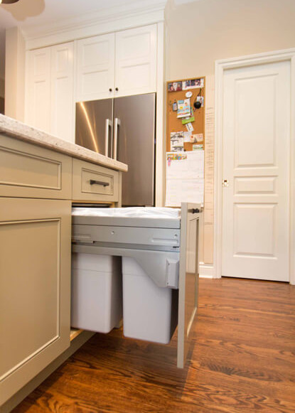 pull-out-garbage-and-recycle-drawer-and-medium-dark-hardwood-flooring-in-traditional-kitchen-with-custom-cabinetry