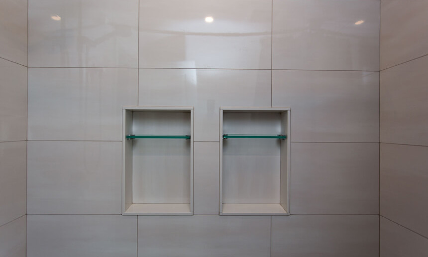 tiled-shower-with-built-in-custom-shelving-and-polished