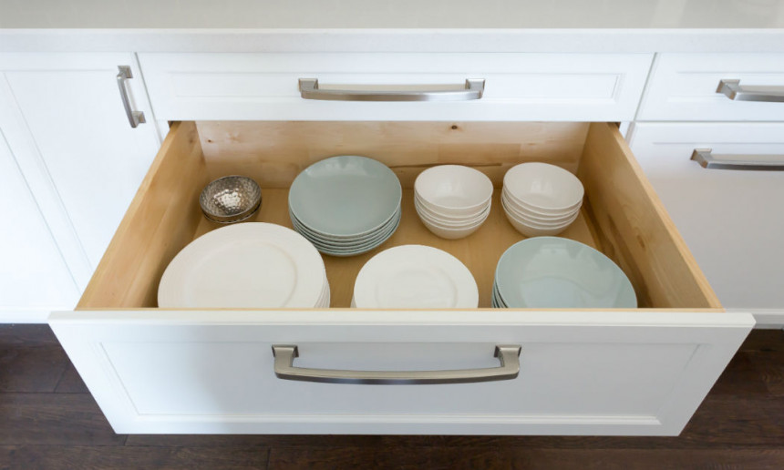 traditional-kitchen-with-custom-white-cabinetry-chrome-hardware-dishes-drawer