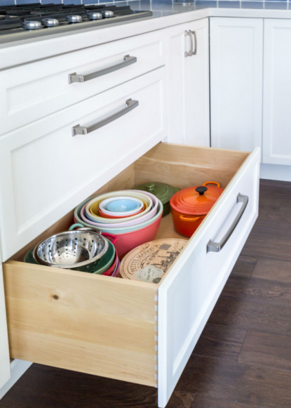 traditional-kitchen-with-custom-white-cabinetry-deep-storage-drawer