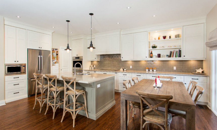 traditional-kitchen-with-wood-table-and-chairs-with-custom-cabinetry-and-pendant-lighting