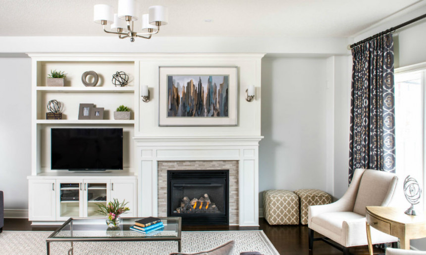 white-custom-cabinetry-with-art-wall-over-fireplace-and-built-in-tv-and-benjamin-moore-wickham-gray-paint-colour-elegant-living-room-3