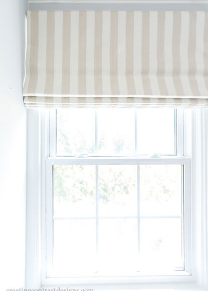 window-treatment-roman-blinds-with-striped-pattern-over-large-window