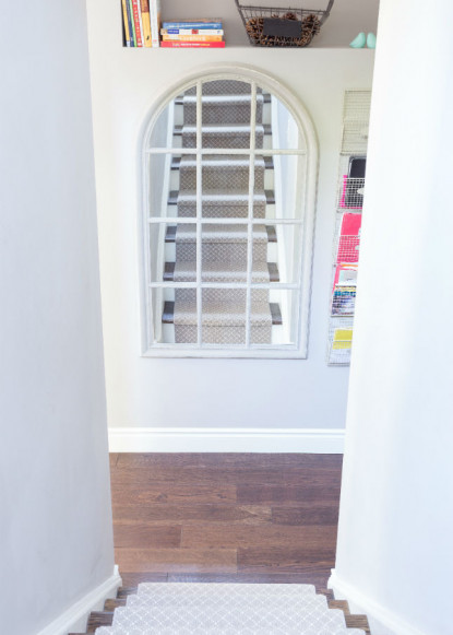 wooden-hardwood-flooring-and-carpeted-staircase-with-mirror-2