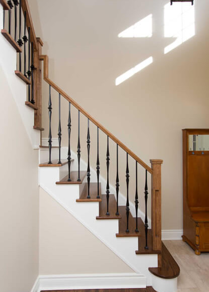 wooden-staircase-with-white-and-tile-flooring-in-front-entry