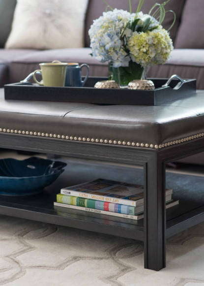 leather-ottoman-table-with-chrome-nail-heads-in-living-room