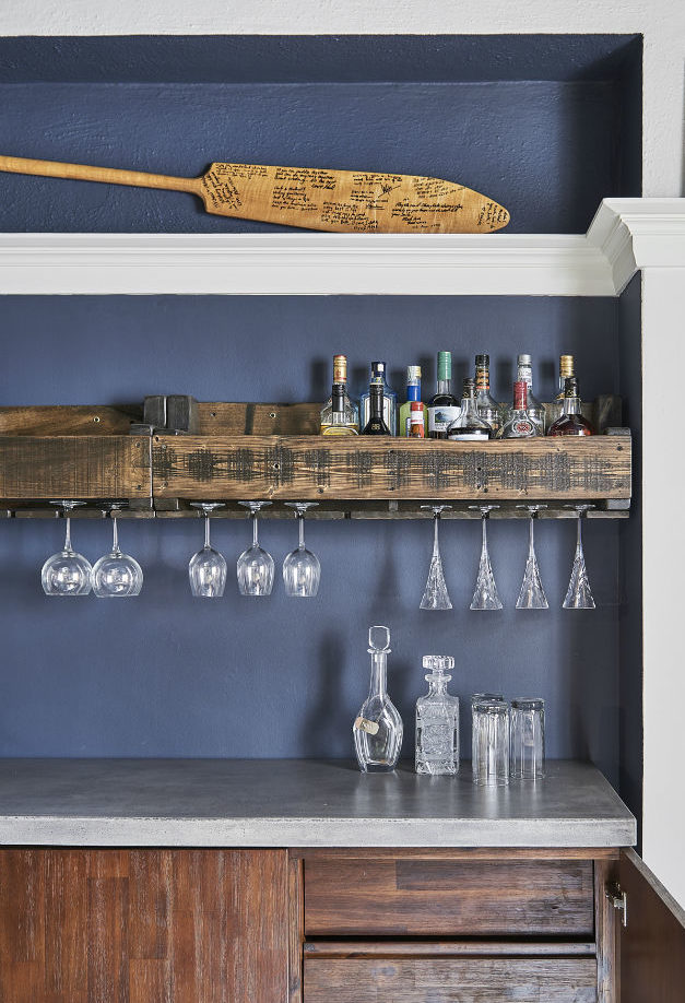 custom-cabinetry-with-wine-decor-and-wine-rail-with-benjamin-moore-hail-navy-wall-and-white-wall-3