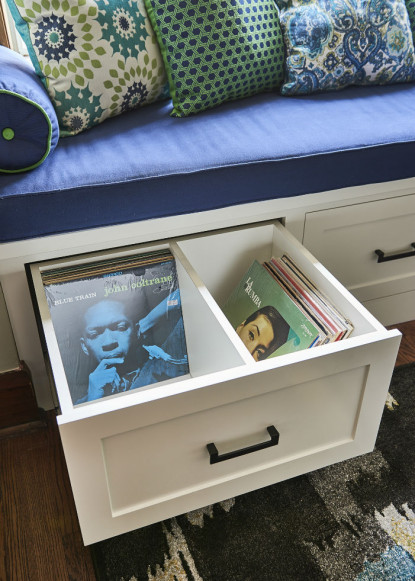 custom-window-bench-seat-with-dark-blue-cushion-and-accent-pillows-with-custom-white-drawer-detail-2