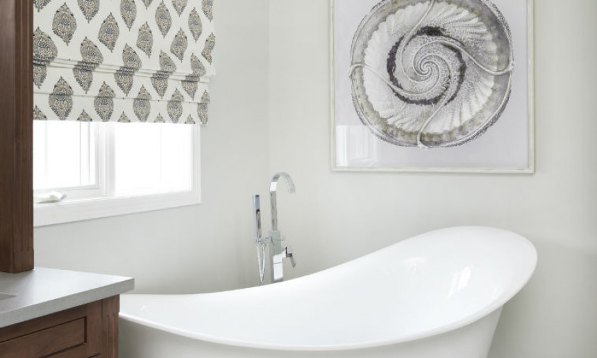 ensuite-bathroom-with-bathtub-and-art-wall-with-roman-blind-window-treatment-with-pattern