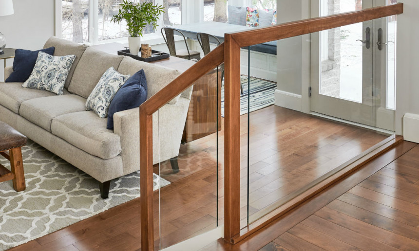glass-and-wood-railing-hardwood-flooring-and-stairs-leading-to-living-room