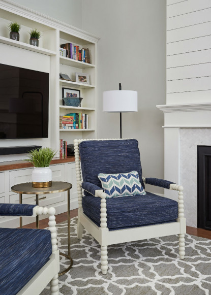 informal-living-room-with-custom-upholstered-blue-chair-and-ikat-area-rug