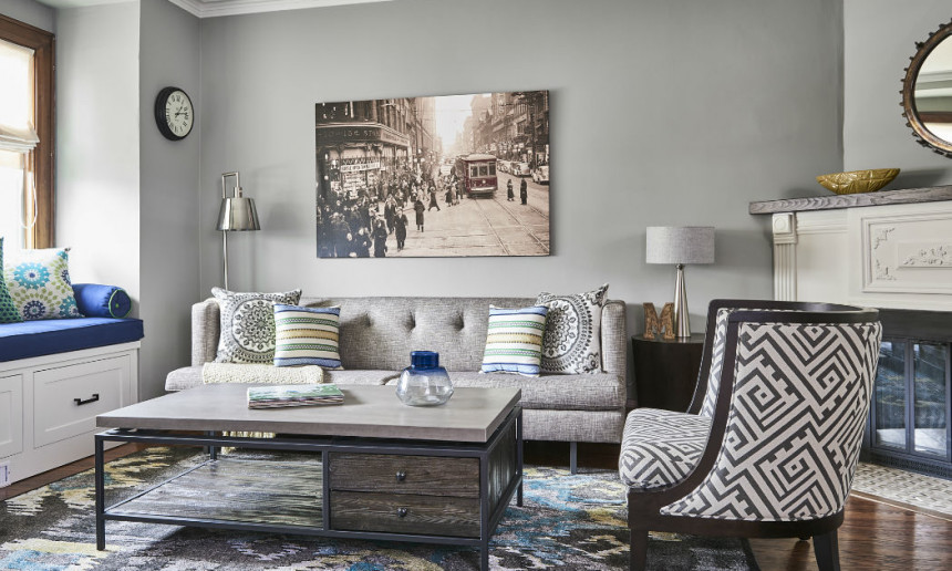 living-room-with-grey-and-blue-accents-and-geometric-patterned-chair-and-toronto-themed-artwork-3