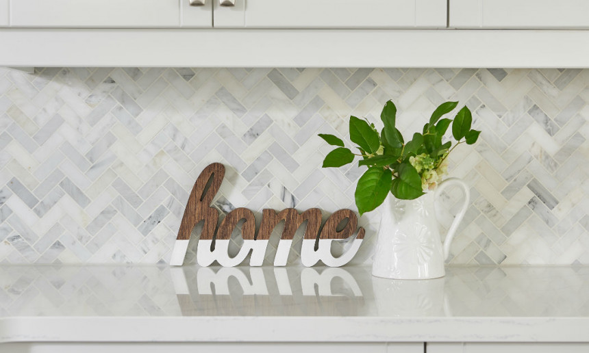 oxford-white-kitchen-cabinets-with-herringbone-pattern-marble-tile-backsplash-2