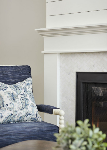 shiplap-detailed-fireplace-with-custom-blue-upholstered-chair-ontario