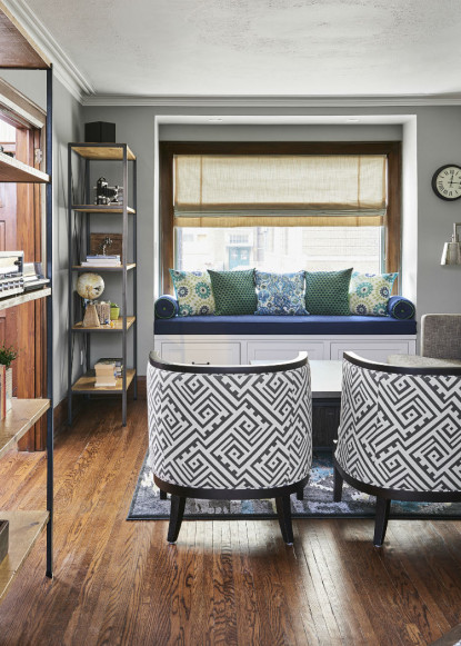 white-and-black-geometric-patterned-chairs-with-medium-dark-hardwood-flooring-and-custom-bench-seat