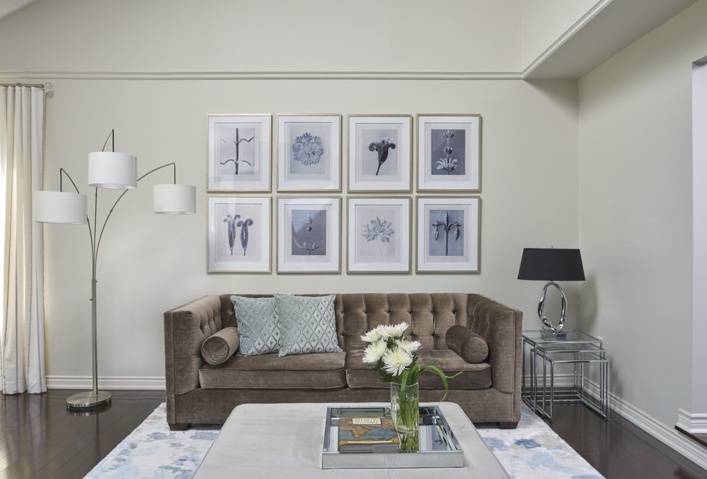 Living Room With Benjamin Moore Classic Gray Walls And Velvet Sofa, Trilamp And Coffee Table