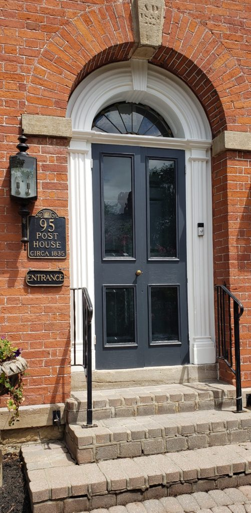 Dark Blue Ahle Navy Front Door Arched Red Brick Closer 1