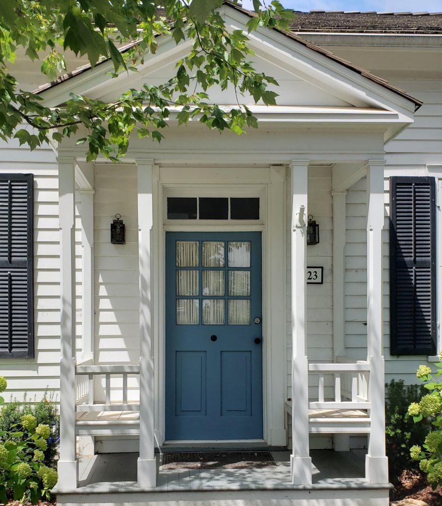 Lucerne Blue Door White Diamond House Black Shutters