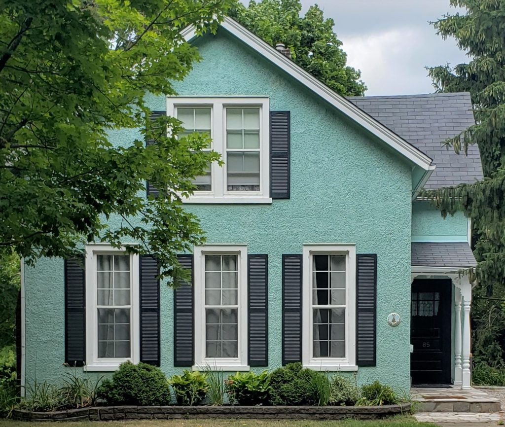 Wedgewood Blue Colour House With Black Door And Black Shutters 1