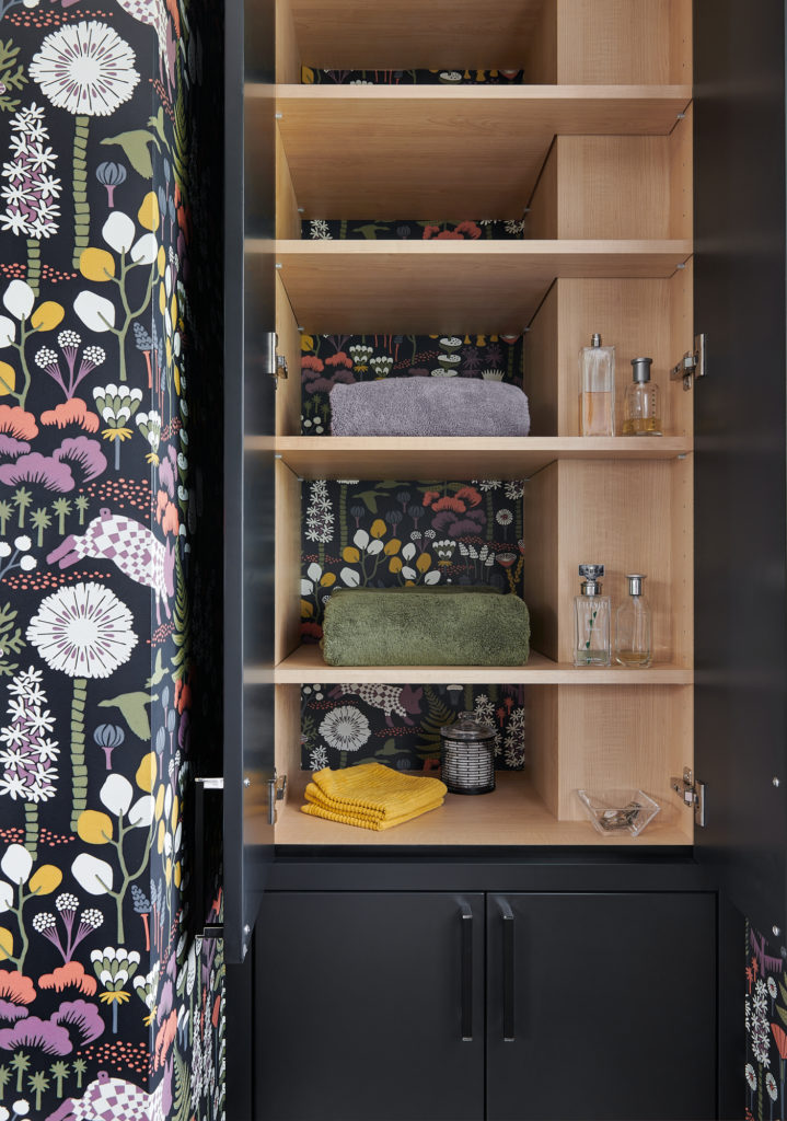 Black Bathroom Custom Cabinet With Shelves And Wallpapered Background