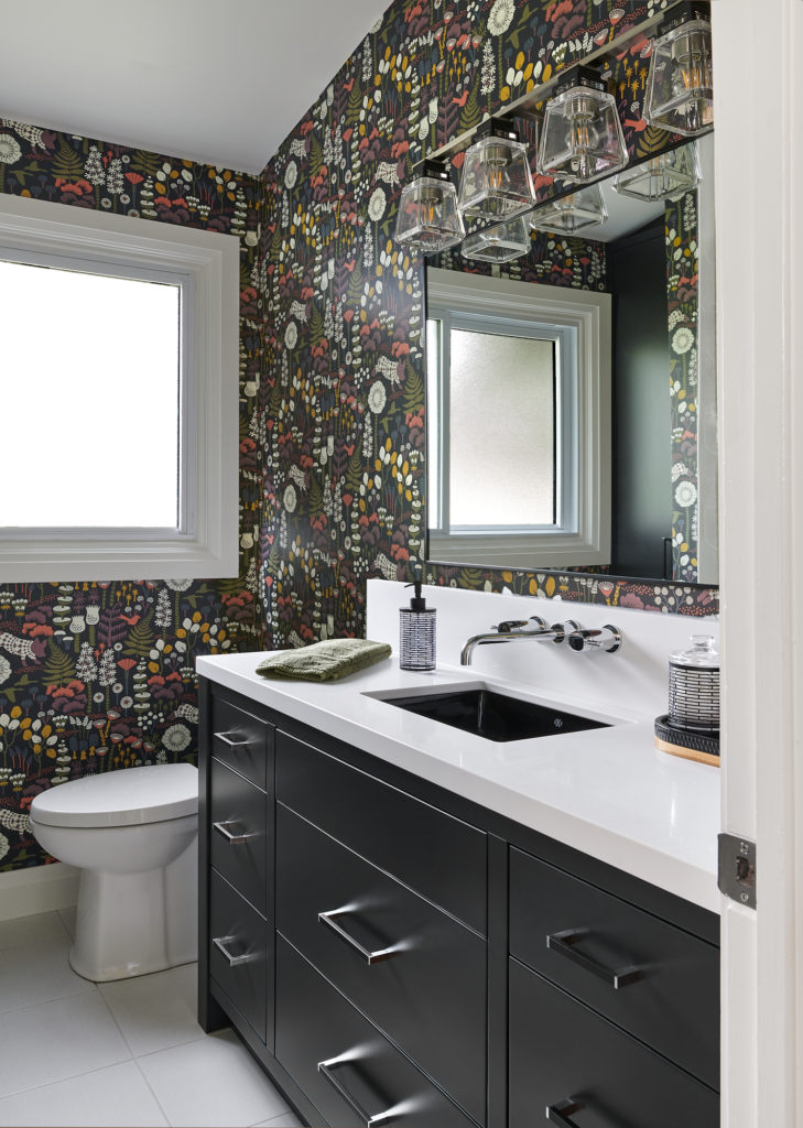 Small Bathroom White Counter Black Vanity Colorful Wallpaper