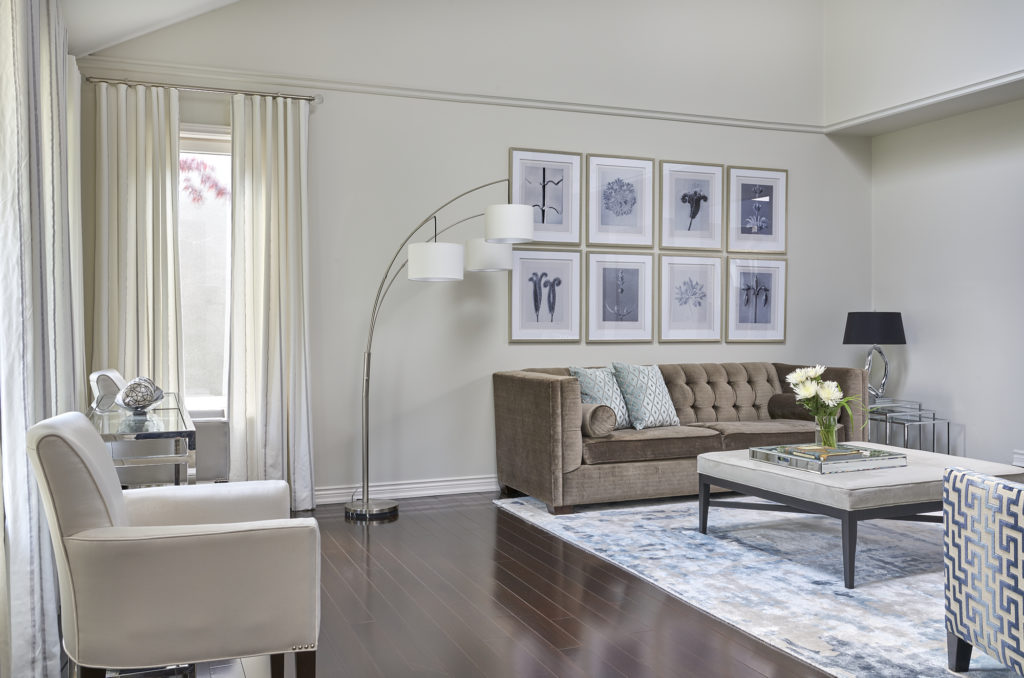 Living Room With Benjamin Moore Classic Gray Walls And Tri Lamp Beside Gallery Art Wall And Classic Sofas