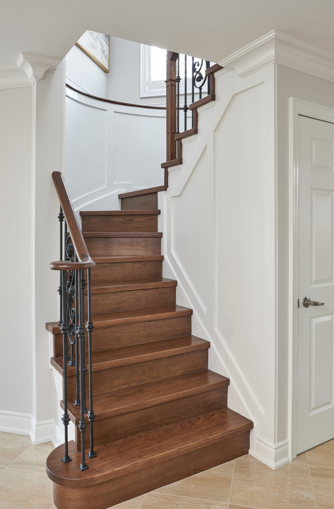 Stunning Hardwood Spiral Staircase With Wainscoting In Oxford White By Benjamin Moore